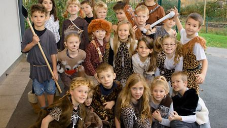Pupils learning about the stone age.