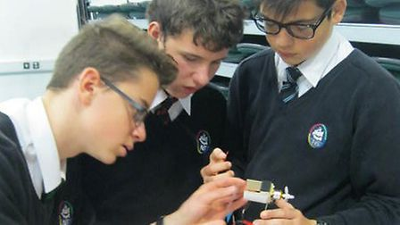 Pupils creating their radio-controlled aeroplane.