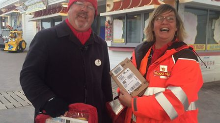 Postwoman Sarah Isles delivering to the Grand Pier.