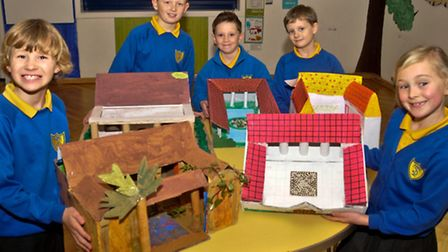 Tickenham Primary School year 3 and 4 pupils with Roman villas they have created.