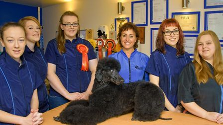 Charley Cullinane and owner Lisa Smith (centre) with Daphne the dog and staff members Jess McLeod, N
