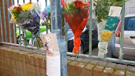 Floral tributes to the young hit and run victim Syful Alom.