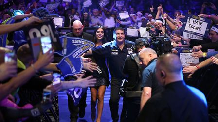 Gary Anderson makes his way to the Oche during day one of the William Hill PDC World Championship at