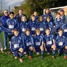 Weston Crusaders U12's team and officials with Charlotte Grant (right) and Andrew Pearce (left) from
