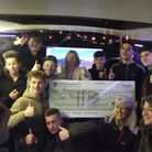 Youngsters from the Grow Your Own Youth project with the cheque from Persimmon Homes.