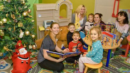 Happy House Nursery has just opened, pics of staff with kids.