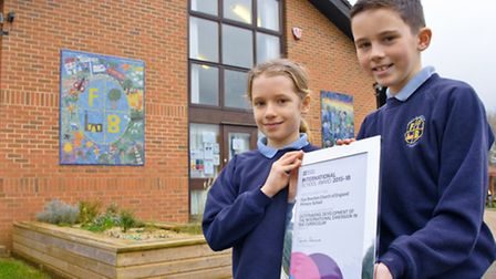 Pupils Lola and Max with the award.