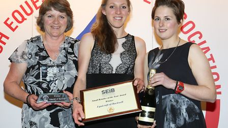 Jane Atherton and Libby Holliday from Equicraft picking up their award with mum Margaret Atherton.