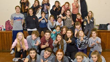 Jonny Purchase (standing on left), from the cast of Les Miserables, with youngsters.