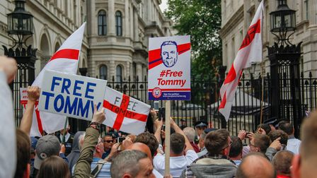 Supporters of Tommy Robinson rush the gates at Downing Street during a 'Free Tommy Robinson' protest