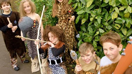 Stone age pupils with artefacts they have made for stone age museum.