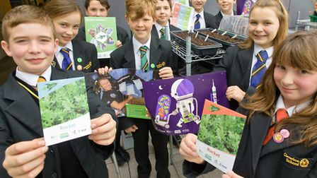 Year seven pupils with the packs of seeds from Tim Peake.