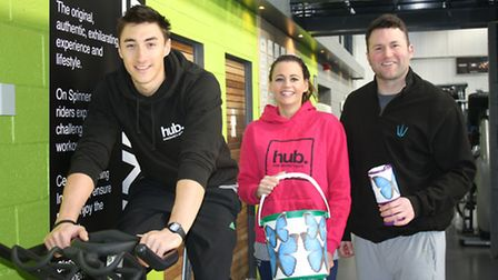 Fitness Hub manager Claire Cleeves with Charlie James on the bike and James Grogan.