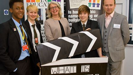 Students with speakers, Jonathan Charlesworth Executive Director of EACH and Sheila Smith North Some