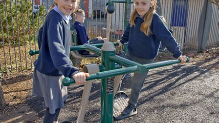 Children at Portishead Primary school who have had new exercise equipment fitted in their playground
