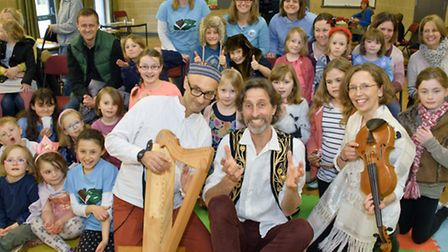 Children and parents with author Michael Loader and musicians Martin Soloman and Alison Francis-Blac