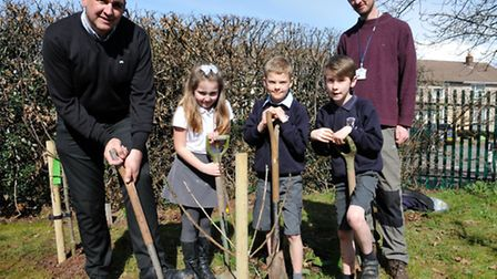 Year 3 pupil Ruby and year 4 pupils Ollie and Samuel with John Atwood from the Forest of Avon Trust