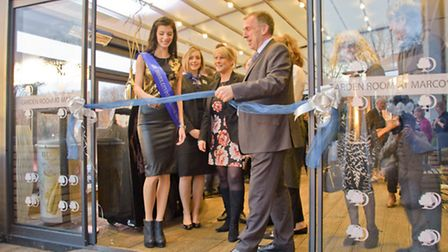Miss Bristol and Colin Badcock cutting the ribbon.