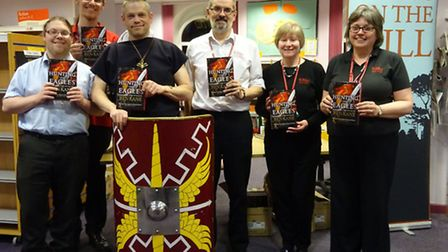 Ben Kane with Alistair Sims, from Books on the Hill in Clevedon, and Yatton Library staff.