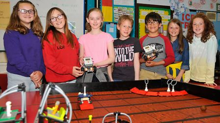 Year 6 pupils with their robots.