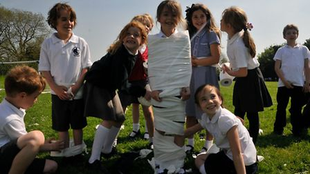 Year 3 pupils taking part in the mummy races.
