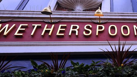 A sign for a Wetherspoon pub. Photograph: Fiona Hanson/PA.