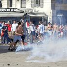 Teargas is fired at England supporters in downtown Marseille, France, Saturiday, June 11, 2016. (AP