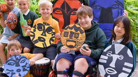 Pupils with African masks and drums.