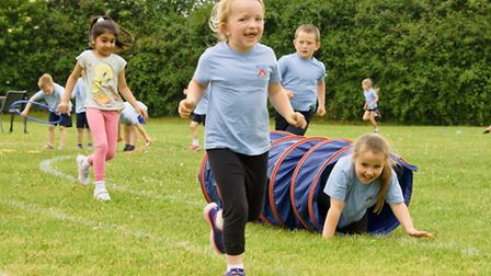 Pupils taking part in sports and games.