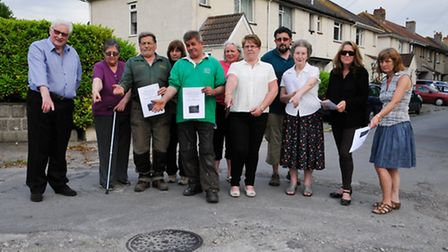 Disgruntled residents and Parish Councillors in the poorly maintaned road.