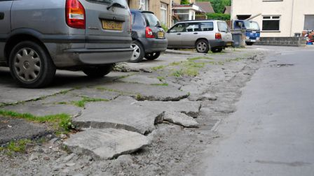 The pavements have been totally destroyed by years of neglect.