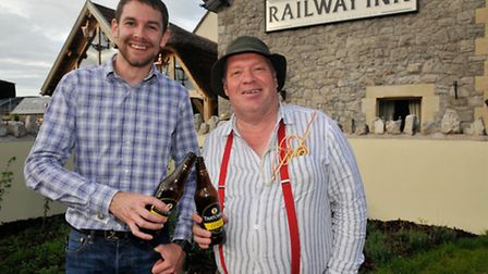 Railway Inn General Manager James King and Event Organiser Phil Smith with the new cider.