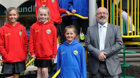 Centre manager Rob Stokell with the children, sporting their new hoodies.
