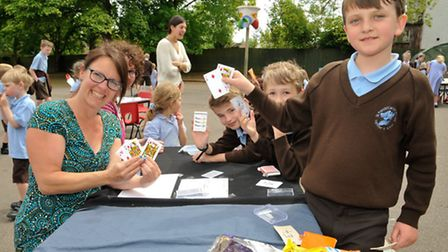 Children at their card games stall.