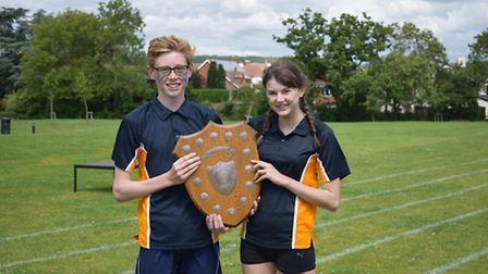 The head boy and girl of unicorn house with the sports day trophy.