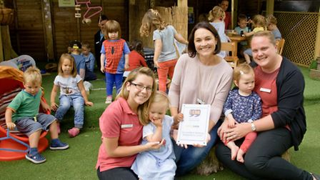 Staff and kids at Stationhouse Nursery who have won I CAN award.