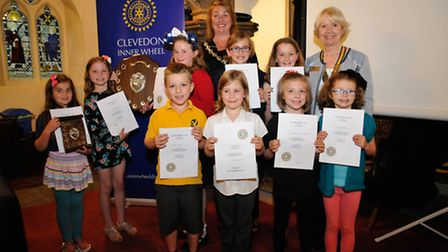Winners of the competition with their certificates and trophies.