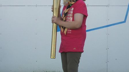 Phoebe Willis with the Olympic torch