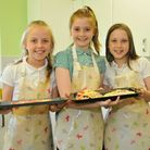 Pupils with the pizzas they made in the new kitchen.