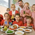 School head chef Steve Fowell with pupils learning about healthy eating.