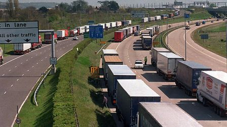 Hundreds of trucks wait their turn to enter the port of Dover on the M20 at Folkestone, Kent. Photog