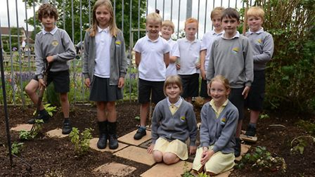 Children in the new garden area they helped to create.