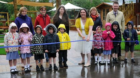 Reception pupils and the school's govenors cut the ribbon to open the new area.