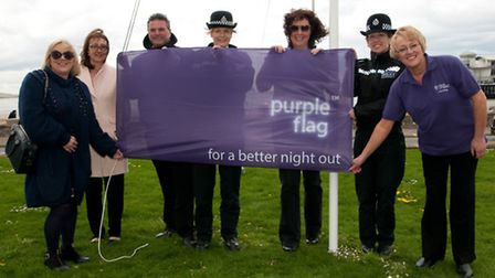 Members of North Somerset Council, Weston BID and Avon and Somerset Police with the purple flag.