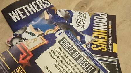 A copy of Wetherspoon's News is ripped up after landing through a letterbox. Photograph: Traceylsl/T
