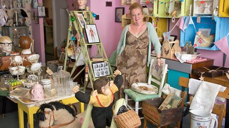 Janet Carson in her shop full of interesting items.