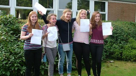 Helen Mann, Beth Ford, Katie Williams and Nina Sundstrom celebrate together after achieving top grad