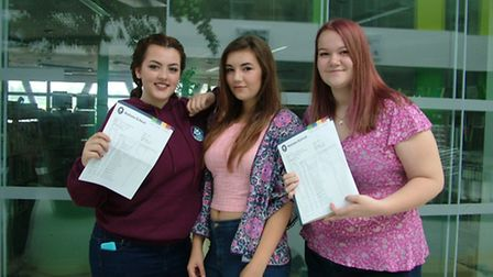 Becky Smith, Naomi Cokes and Phoebe O'Connor celebrating their results at Nailsea School.