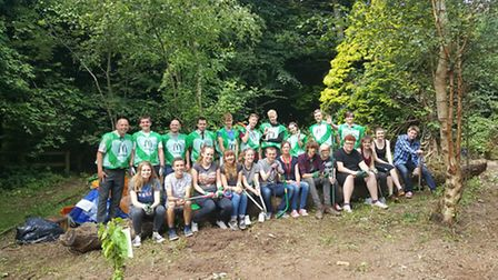 Students and volunteers from McDonald's setting up an outdoor classroom at Gordano School.