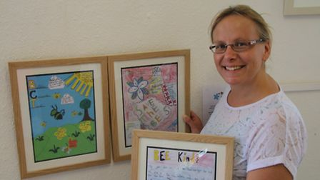 Janice Walsh with some of the best posters made by the pupils.